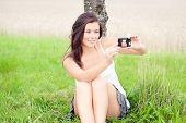 Cute Teen Taking Self-portrait With Digital Camera