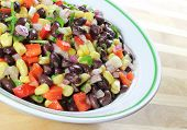 stock photo of southwest  - Southwest Black Bean Salad in a bowl sitting on a table - JPG