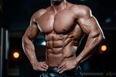 Brutal Strong Bodybuilder Athletic Men Pumping Up Muscles With Dumbbells. poster