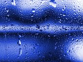 Drops on blue glass