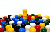 stock photo of chinese checkers  - Pegs on a chinese checkers board conceptually depicting someone being on top of it being the best - JPG