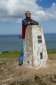 Man And Trig Point.