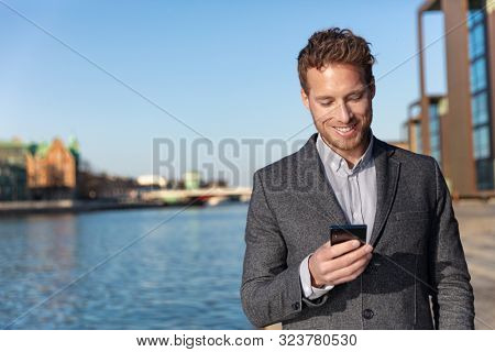poster of Business man texting on mobile phone using app for sms text message 5g technology. Young Caucasian b