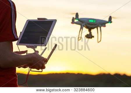 poster of drone flying. copter pilotage at sunset
