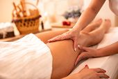 Masseuse Applying Her Techniques On A Woman's Thigh poster