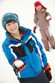 foto of snowball-fight  - Two Young Children Having Snowball Fight Wearing Woolly Hats - JPG