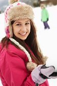 pic of snowball-fight  - Teenage Couple Having Snowball Fight Wearing Fur Hats - JPG