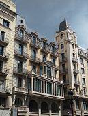 Building Frontage Under A Storm Sky, Barcelona Center , Spain