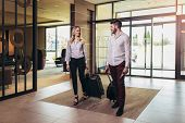 Young Couple Near Reception Desk In Hotel. Young Couple Comes To The Hotel poster