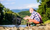 Active Lifestyle And Hobby. Fly Fish Hobby Of Men. Retirement Fishery. Two Male Friends Fishing Toge poster