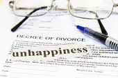 stock photo of divorce-papers  - Divorce Paper with unhappiness cutout and pen - JPG