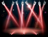 stock photo of flood-lights  - A red spotlight background concept with lots of lights like spotlights in a light show or during a dramatic theatre stage performance - JPG