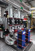 stock photo of pipeline  - Interior of independent modern gas boiler room with manometers valves pumps and thermo - JPG