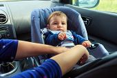 Baby Car Seat For Safety. Cute Boy In Safety Car Seat With Safety Belt Locked Protection. Protection poster