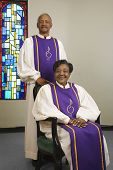 Senior African couple wearing church choir gowns