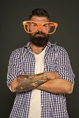Eyeglasses Perfect For His Style. Cool Guy Wearing Party Eyeglasses On Grey Background. Brutal Hipst poster