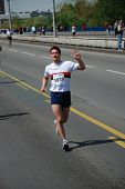 BELGRADE, SERBIA - APRIL 22: Undefined man runs on April 22, 2012 in 25th Belgrade marathon