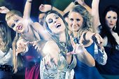 Young people dancing in club or disco party, the girls and boys, friends,  having fun