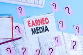 Text Sign Showing Earned Media. Conceptual Photo Publicity Gained Through Promotional Efforts By Mul poster