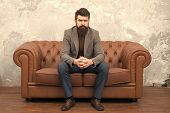 Classy But Casual. Bearded Man Relaxing On Sofa. Man Or Businessman Wearing Informal Suit. Fashion M poster