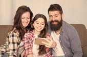 Happy Family At Home. Little Girl Use Smartphone With Mother And Father. Family With Happy Mood. Hap poster