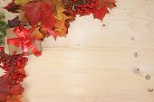 Thanksgiving, Autumn Background With Seasonal Maple And Rowan Leaves And Gifts On A Wooden Backgroun poster