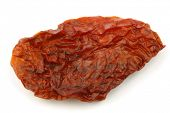 Sun dried tomato piece on a white background