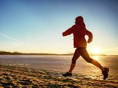 Woman Jogging On Winter Beach Run. Female Athlete Runner Jogger Training Living Healthy Active Exerc poster