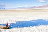tourists in Badwater (the lowest point in North America), Death Valley National Park, California, USA
