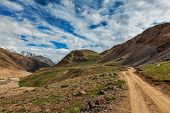 Dirt road in Spiti valley in Himalayas. Spiti valley, Himachal Pradesh, India poster