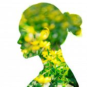 Double exposure portrait of beautiful girl in profile. Young woman with spring yellow flowers. Youth poster