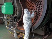stock photo of ppe  - the cleaning of an industrial steam boiler - JPG