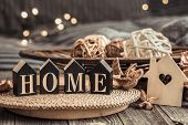 Still Life With Objects Of Festive Home Decor And Wooden Letters With The Inscription Home, Near A S poster
