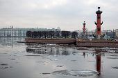 View Of The Spit Of Vasilevsky Island. Rostral Columns. Drifting Ice On The Neva.