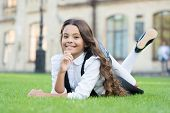 School Break For Rest. Happy Smiling Pupil. Girl Cute Kid Laying Green Grass. Happy Kid Relaxing Out poster