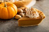 Traditional Pumpkin Pie Topped With Whipped Cream poster