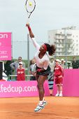 KHARKOV, UKRAINE - APRIL 22: Serena Williams serve a ball during Fed Cup tie between USA and Ukraine in Superior Golf and Spa Resort, Kharkov, Ukraine at April 22, 2012