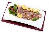 Plate With Grilled Steak And Potatoes