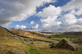 stock photo of errat  - Moughton Scar and Wharfe Dale viewed from Norber Erratics in Yorkshire Dales National Park - JPG