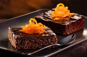 stock photo of brownie  - Homemade Chocolate Brownie on a dark plate against a dark background - JPG