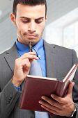 Businessman reading his agenda
