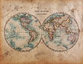 A genuine old stained World map dated from the mid 1800's showing Western and Eastern Hemispheres wi