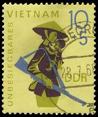 Gdr - Circa 1968: A Stamp Printed In Gdr, Show Thevietnam   Woman With A Gun And The Child On Hands,