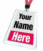 The words Your Name Here on a plastic nametag badge and lanyard for a special event, convention or c