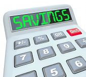 stock photo of plastic money  - A plastic calculator displays the word Savings symbolizing the discount from a sale - JPG