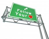Follow Your Heart to future of success, dreams and growth.  That's the message of this freeway sign with an arrow pointing to a path that takes you where you want to go