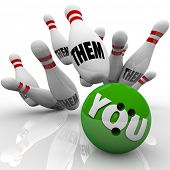The word You on a green bowling ball striking many pins with the words Them to symbolize your chance