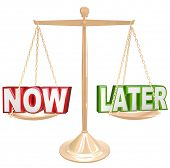Weighing the pros and cons of completing a task now or procrastinate, with the words Now and Later o
