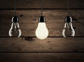 pic of uniqueness  - unique bulb on wooden background - JPG