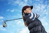 picture of ladies golf  - Pretty young lady golfer view from below against a blue sky - JPG